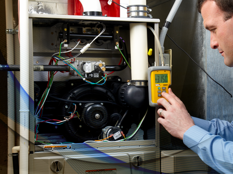A technician installing a heating system